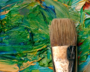 Close up of artists palette, oil paints and brush