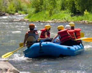 Rafters negotiate white water on a beautiful Colorado summer afternoon.